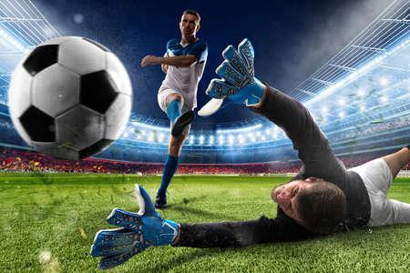 Goalkeeper kicks the ball in the stadium Foto de archivo