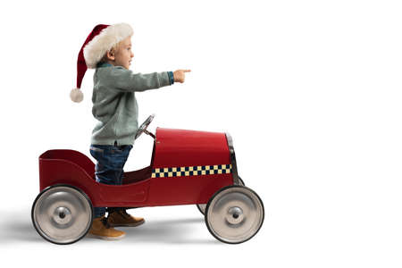 Child that play with his car waits for Santa Claus Standard-Bild