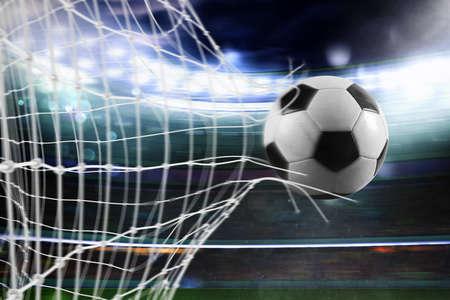 Soccer ball scores a goal on the net Banco de Imagens - 90144548