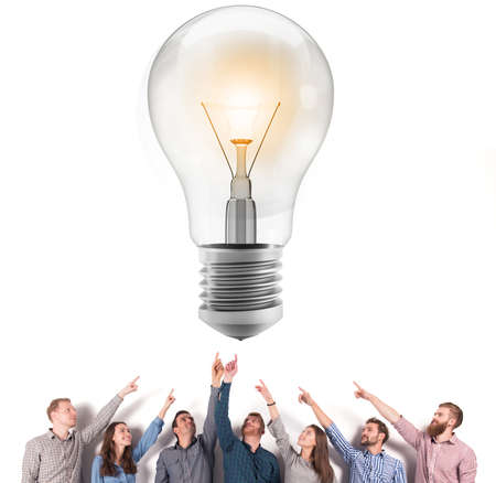 Brainstorming concept with businessmen that indicate an a lamp. Concept of idea and company startup Stock Photo