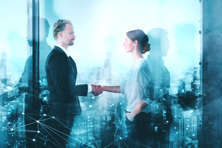 Handshake of two businessperson in office with network effect. concept of partnership and teamwork