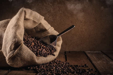 Coffee beans on grunge background Stock Photo