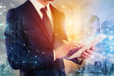Businessman shares document with tablet. Internet network effect on background Standard-Bild