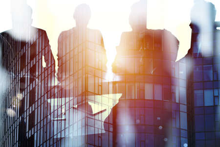 Businessmen that work together in office. Concept of teamwork and partnership Standard-Bild
