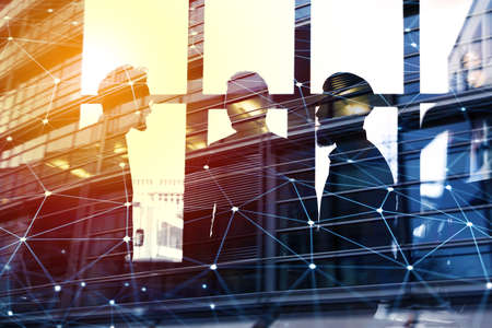 Businessmen that work together in office with network connection effect. Concept of teamwork and partnership. double exposure