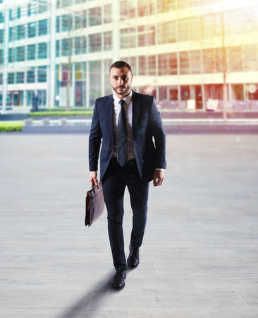 Determinated businessman walking in the city Stock Photo