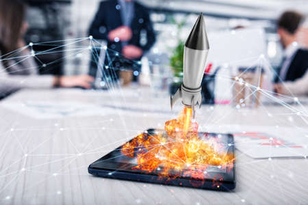 Rocket ready to starts from a tablet. concept of company startup Stok Fotoğraf