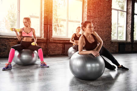 Girls working out at a gym with the gymball Stock Photo