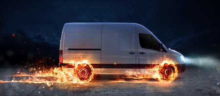 Super fast delivery of package service with van with wheels on fire Foto de archivo