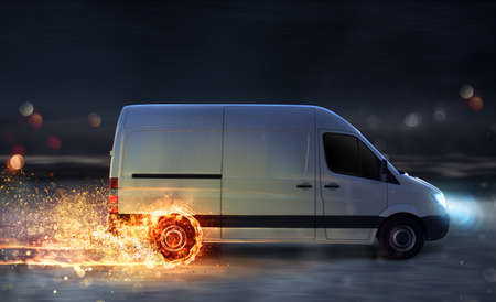 Super fast delivery of package service with van with wheels on fire Stock Photo