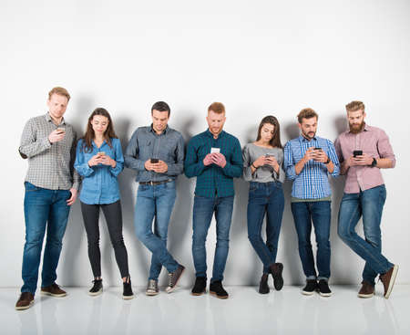 Group of boys and girls connected with their smartphones. Concept of internet and social network Stock Photo