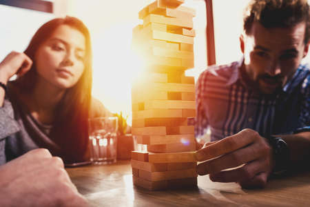 Team of business people build a wooden construction. concept of teamwork ,partnership and company startup Stock Photo