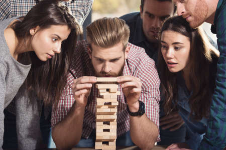 Team of business people build a wooden construction. concept of teamwork ,partnership and company startup Standard-Bild