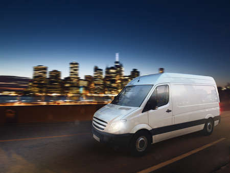 Fast van on a city road delivering at night. 3D Rendering Фото со стока