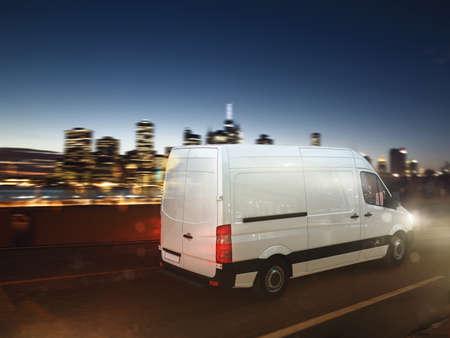 Fast van on a city road delivering at night. 3D Rendering Zdjęcie Seryjne