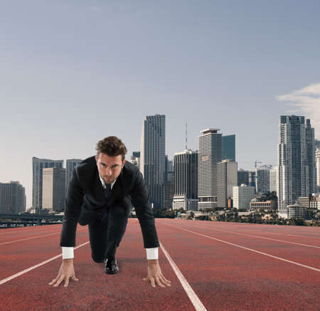 Businessman acts like a runner. Competition and challenge in business concept Banco de Imagens