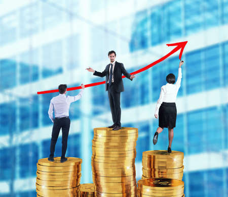 Business team draws growing arrow of company statistics over the piles of money Stock Photo