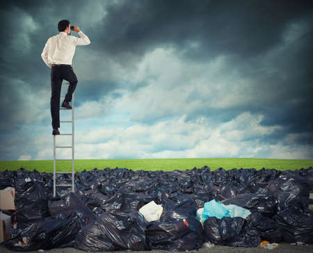 Businessman on a stairs searches far for clean environment. overcome the global pollution problem