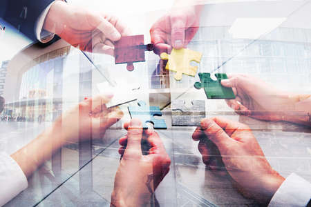 Teamwork of partners. Concept of integration and startup with puzzle pieces. double exposure Stockfoto