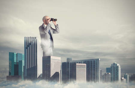 Businessman looks far for new business. Concept of new opportunities Stock Photo