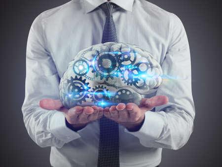L'homme tient un cerveau avec des engrenages à l'intérieur sur ses mains. Rendu 3D