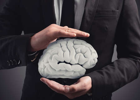 Man protects a brain with his hands. 3D Rendering Banco de Imagens - 97944759