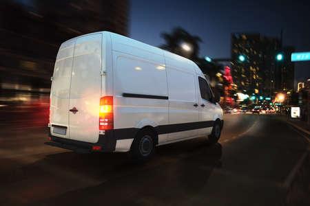Fast van on a city road delivering at night. 3D Rendering Foto de archivo