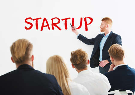 Businessman speaks about a new startup during a training meeting. Concept of success