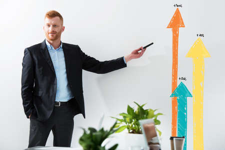 Businessman draws positive statistics of his company. Concept of success Stock Photo