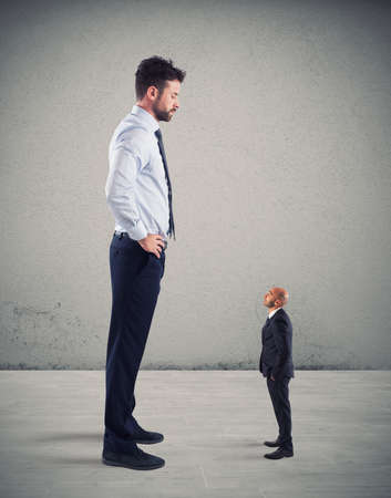 Small businessman terrified by his big boss