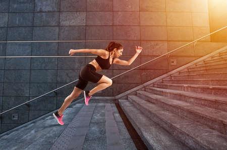 Girl runs fast on a modern stair Zdjęcie Seryjne