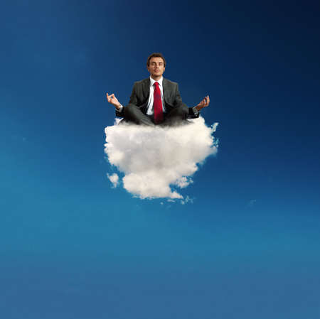 Stressed businessman practice yoga on a cloud 스톡 콘텐츠