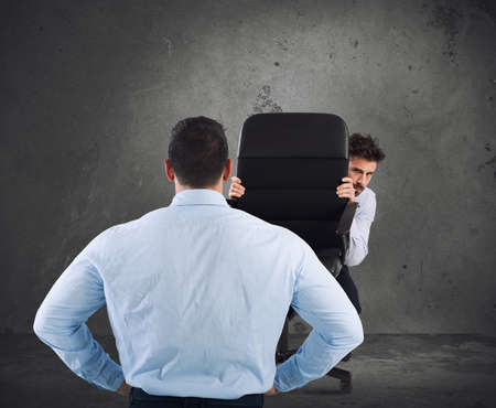 Businessman is afraid of his boss Stock Photo