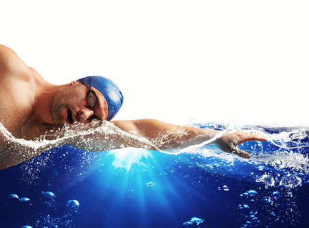 Boy swims in a blue deep water . white space for your text Stock Photo