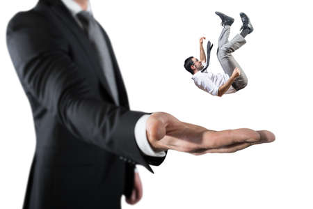 Businessman is saved from a big hand. Concept of business support and assistance Stok Fotoğraf - 99898218