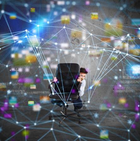 Businessman behind the chair has fear of internet technology Stok Fotoğraf