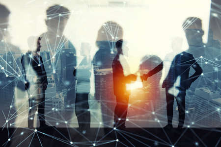 Handshaking business person in office with network effect. concept of teamwork and partnership. double exposure Imagens