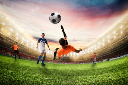 Soccer striker hits the ball with an acrobatic bicycle kick. 3D Rendering Фото со стока