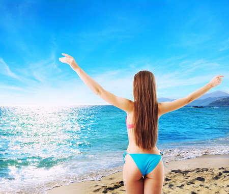 Woman in bikini starts holiday. concept of freedom and relax Standard-Bild
