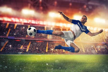 Soccer striker hits the ball with an acrobatic kick Фото со стока