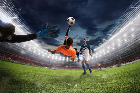 Soccer striker hits the ball with an acrobatic bicycle kick. 3D Rendering 스톡 콘텐츠