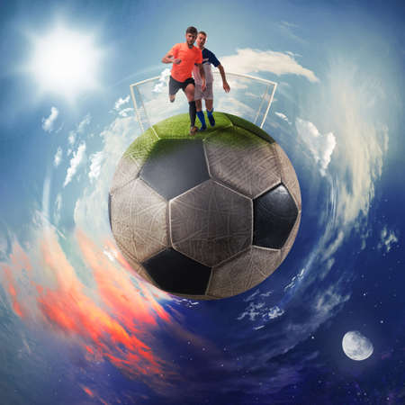 Football players in a soccer ball planet Stock Photo