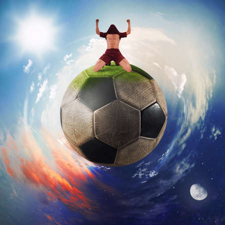 Football player exults in a soccer ball planet