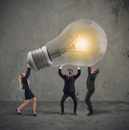 Business people hold a light bulb. concept of new idea and company startup