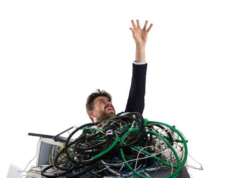 Businessman trapped by cables. concept of stress and overwork