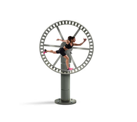 Athletic woman runs in a looping wheel. concept of sport routine