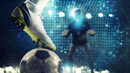 Close up of a soccer striker ready to kicks the ball in the football goal