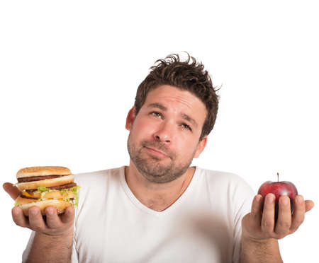 a man confused between healthy and unhealthy food