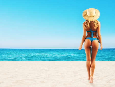 Beautiful girl in a tropical beach ready for summer holidays