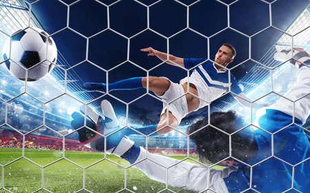 Soccer striker hits the ball with an jumping kick Фото со стока